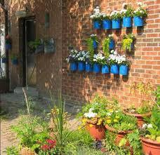 vertical garden design adding natural look to house exterior and