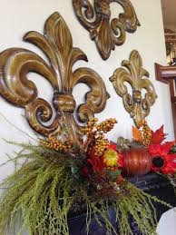 the tuscan home tuscan style wall shelf decorated for fall