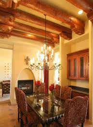 southwestern style homes with beam ceiling and chandelier and