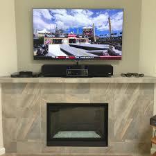 mounting a tv above a fireplace binhminh decoration