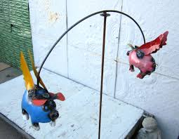recycled metal pig balance on wire yard stake