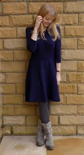 navy knitted skater dress and grey biker boots what