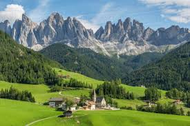 mountain backdrop view of church and mountain backdrop val di funes bolzano