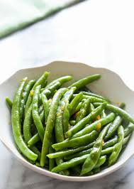 green bean thanksgiving recipes sriracha orange glazed green beans recipe simplyrecipes com