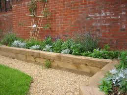plastic garden edging ideas brick raised garden along a brick wall adds color garden pinterest