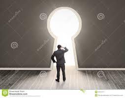 Keyhole Doorway Businessman Looking Through A Keyhole Shape Door Royalty Free