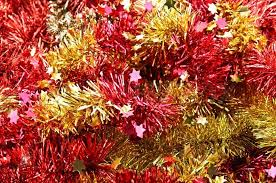 background from and yellow christmas tinsel stock photo