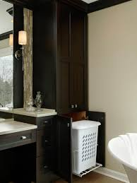 hamper hideaway in custom bathroom cabinet hgtv bathroom cabinet