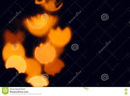 orange festive abstract blurred background for halloween stock