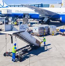 United Airline Stock People With Air Bridge And United Aircraft Standing At Terminal