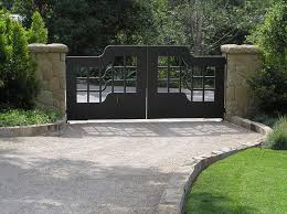 modern gravel driveway landscape asian with entry gate stone