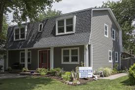 groovy gambrel style roof and whole house siding replacement