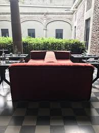 living room design inspiration from mexico city s downtown hotel double sided orange velvet sofa at downtown hotel in mexico city