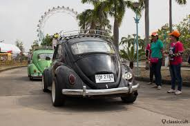 pushing a 2014 volkswagen beetle siam vw festival 2014 bangkok thailand classiccult
