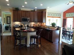 stained wood kitchen cabinets dark brown stained wooden cabinet with cream kitchen island having