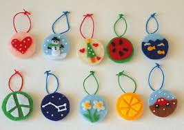 make homeamde felt milk jug cap ornaments pink stripey socks