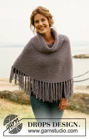 drops design poncho pompom drops 134 15 free knitting patterns by drops design