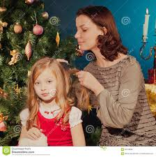 Mother Daughter Christmas Ornaments Mother And Daughter Near Christmas Tree Stock Photo Image 62440898