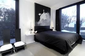 black and white bedrooms with color accents deep sky blue bed