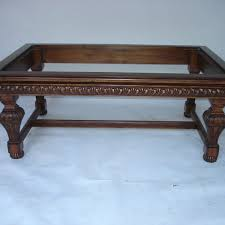 hand carved coffee table unf sp 602 hand carved coffee table in medium walnut finish with