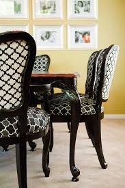 antique dining table and chairs refinished in black lacquer and