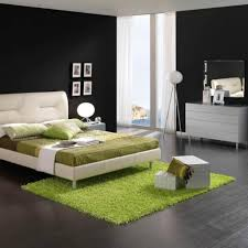 green carpet with white extra high headboard for modern bedroom