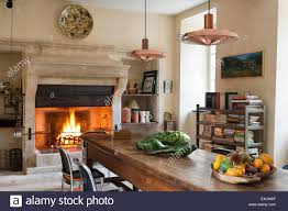 Large Wooden Dining Table by Provencal Kitchen With Large Stone Fireplace And Wooden Dining