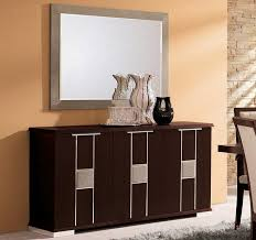 graceful dining room buffet with three doors and decorated wall