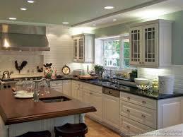 white kitchen cabinets dark countertops white appliances country