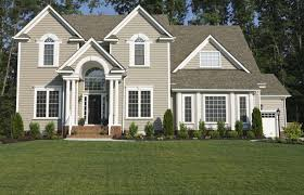 luxurious green house exterior paint idea with white window frames