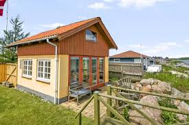 small house bliss designs with big impact this tiny beachfront cottage denmark has the ground floor plus