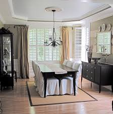 swing arm curtain rod in dining room traditional with rug under