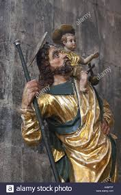 statue of st christopher with baby jesus stock photo royalty free