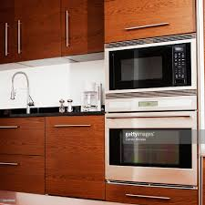Kitchen Microwave Cabinets Oven Microwave Cabinets And Sink In Modern Kitchen Stock Photo