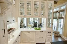 Glass Front Kitchen Cabinets Set In A Wooden Frame Kitchen - Kitchen cabinet sets