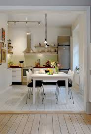 eat in kitchen island light wood island top gray tiles flooring