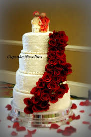 whiteivory lace wedding cake adorned with a cascade of fresh red