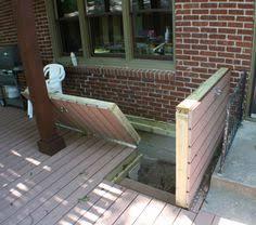 basement access stair doors hidden under removable deck panels