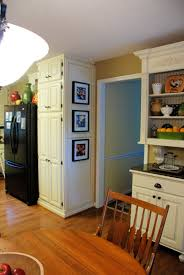 Distressed White Kitchen Cabinets by Remodelaholic From Oak Kitchen Cabinets To Painted White Cabinets