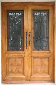 Designer Door by Creating An Elegant First Impression With Wrought Iron And Timber