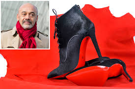 christian louboutin scrambles to trademark his red soled shoes
