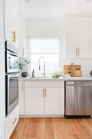 white kitchen cabinets with oak floors before after a los angeles home transformation