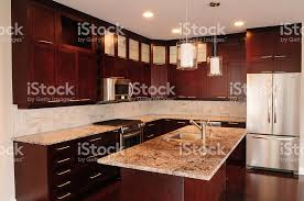 Maple Kitchen Cabinets With Granite Countertops Walnut Stain On Maple Cabinets Granite Countertops Stock Photo