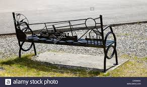 ornamental wrought iron seat or bench with nautical theme at stock