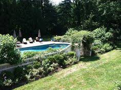 Landscaping Around Pools by White Picket Fence And Boxwoods Around Pool Outdoor Pinterest