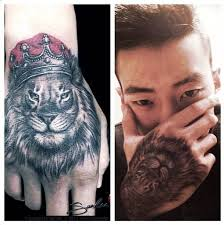 jay park shows off his new king of the jungle tattoo allkpop com