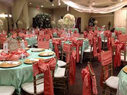 quinceanera decor in mint and coral at villatuscanaevents com