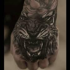 hand tattoos gallery tiger hand tattoo best tattoo ideas gallery