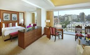 Bed And Living Treat You The Nile Ritz Carlton Cairo