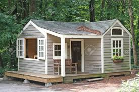 a small cabin in a wooded area stock photo picture and royalty